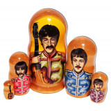 Nesting doll popular singers Beatles with guitar in military costumes