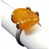 Amber ring with a large insert