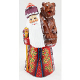 New Year and Christmas carved wooden toy Santa Claus with a bear on...