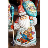 New Year and Christmas carved wooden toy Santa Claus is small,...