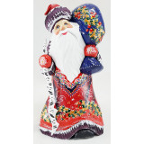 New Year and Christmas carved wooden toy Santa Claus with a birch...