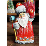 New Year and Christmas carved wooden toy Santa Claus with a bag,...